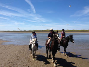 Auriel on horseback with 2 other riders on Heritage on Horseback Trail on Trawalua Beach