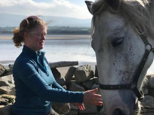 Auriel Robinson stroking grey horse