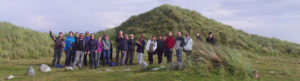 Seatrails hikers in front of grassy dunes