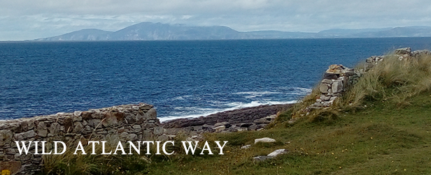 gap in stone wall and view of wild atlantic way across to slieve league
