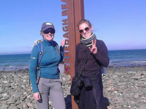 Auriel with friend beside Streedagh beach sign