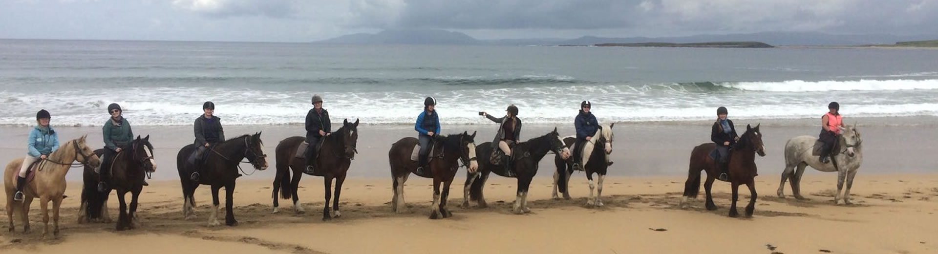 Group of riders on beach with Seatrails in Summer time