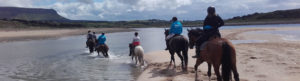 Riding on a beach during Heritage on Horseback experience with Seatrails
