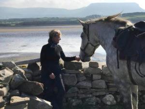 Girl petting Connemara mare on Conor's Island in Sligo
