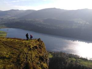 Two Seatrails Walkers On Cliff At Devil's Chimney Overlooking Glencarlencar