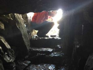 Seatrails Walker in doorway of Carrowkeel Megalithic tomb