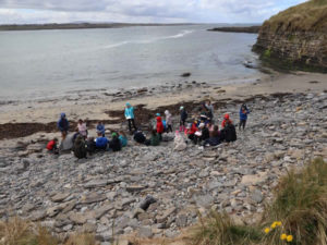Auriel teaching the children about fossils on a Seatrails visit by the shore