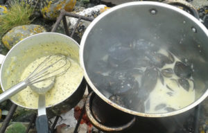 Pots of mussels cooking on rocks on Strandhill Heritage Trail