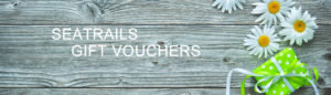 Seatrails Gift Vouchers written on plant of wood with daisies